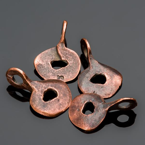 4 Cast doodad charms in bronze, 18 x 11