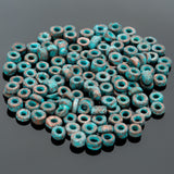 3 Grams Green patina metalized ceramic 1.5 to 3 x 3.5mm seed beads, 1.5mm hole