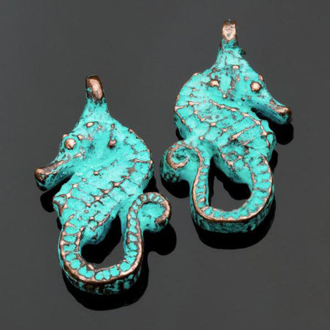 2 Cast green patina seahorse charms, 25 x 15mm