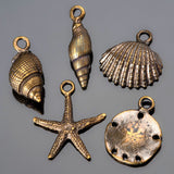 Antique brass cast sea shell charm mix