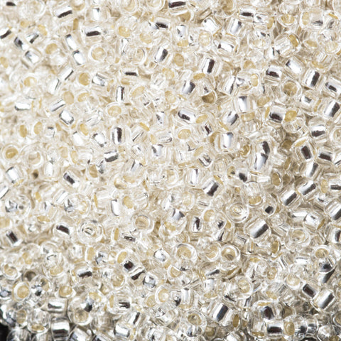 CLEARANCE 15/0 Toho Round Silver lined #21 crystal, 8 gram bag or tube, 19 beads per inch