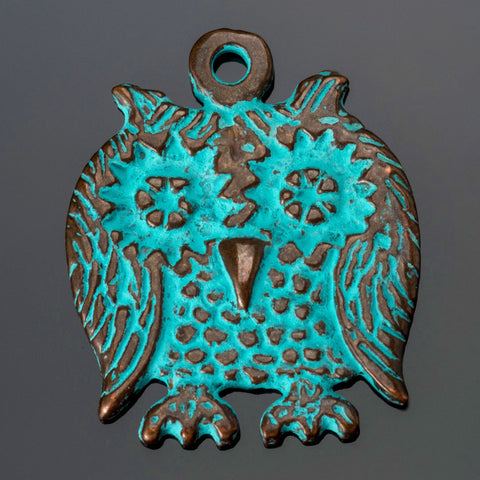 Cast Screech owl pendant in green patina, 23 x 28mm