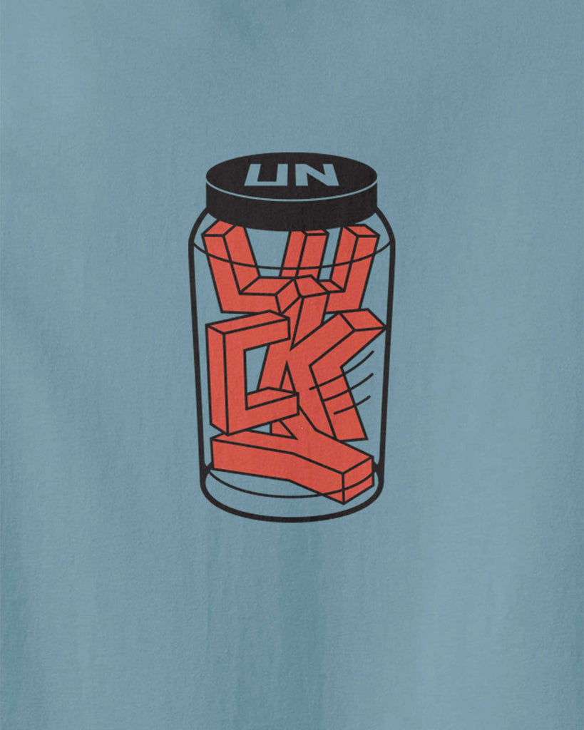 "The graphic of LUCKY words are trapped in a jar with ""UN"" lid"