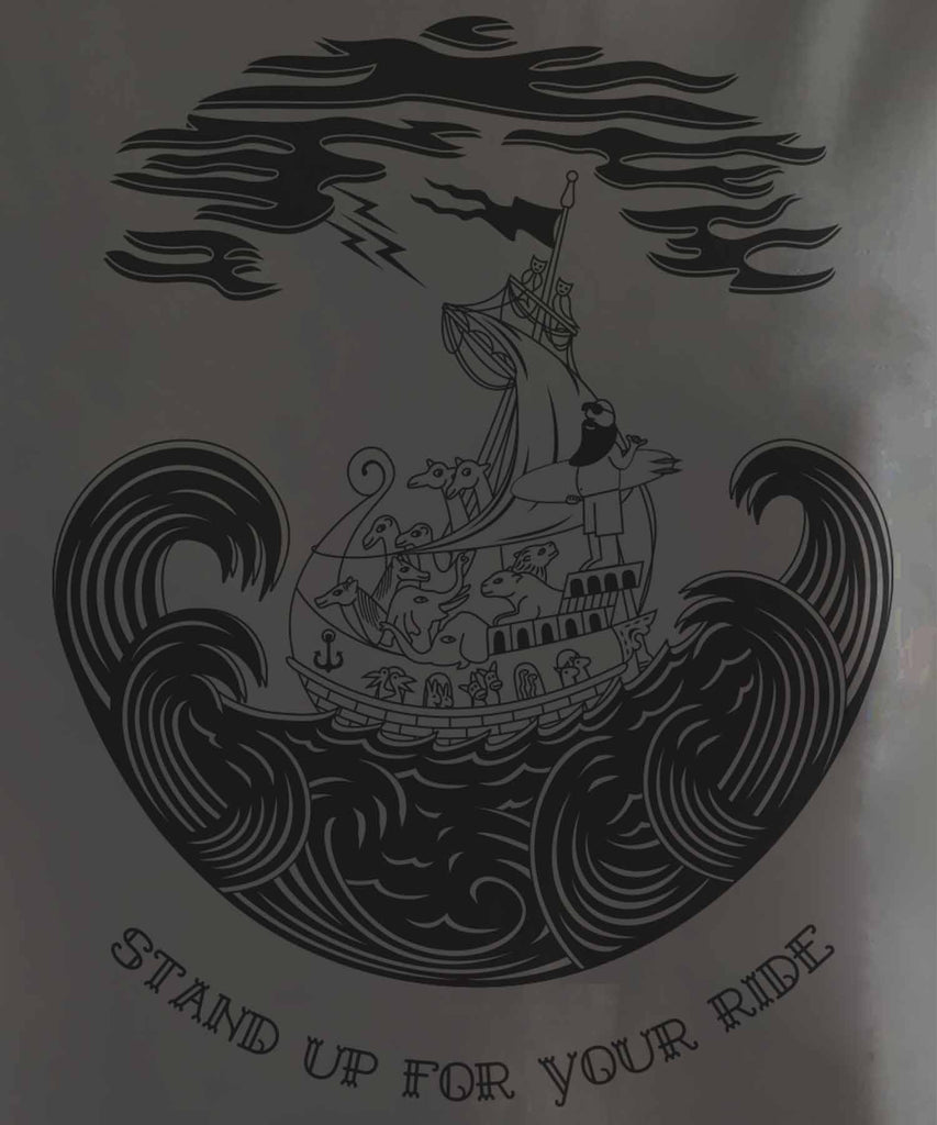 "The graphic of happy Noah holding his surfboard in the ship with all animals and slogan of ""stand up for your ride"""