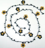 10.14.16 Black and Yellow Daisy Crochet beaded flower lariat necklace with Black Onyx Stones.
