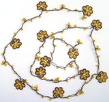 10.19.11 Yellow and Brown Crochet beaded OYA flower lariat necklace with Golden Beads.