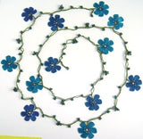 10.20.12 Blue OYA Flower Lariat Necklace with purplish black beads.