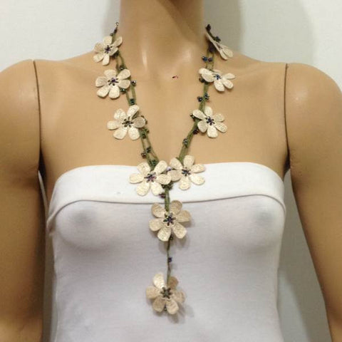 10.20.14 Beige OYA Flower Lariat Necklace with purplish black beads.