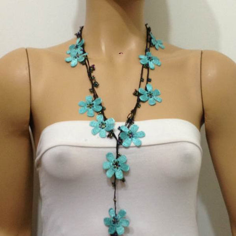 10.20.16 BLUE OYA Flower Lariat Necklace with black strand and purplish black beads.