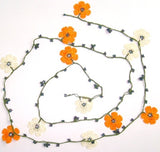 10.20.18 ORANGE and White OYA Flower Lariat Necklace with purplish black beads.