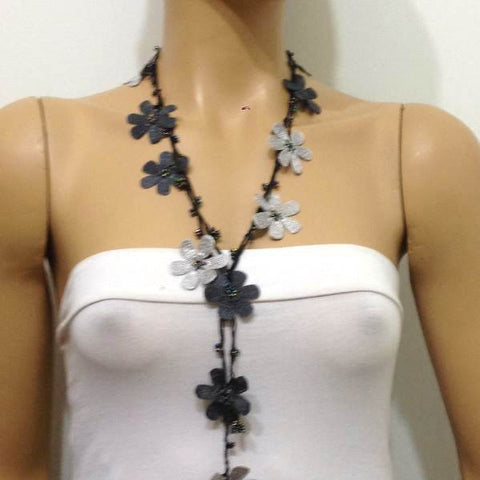 10.20.21 BLACK and Gray OYA Flower Lariat Necklace with purplish black beads.