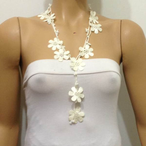 10.20.27 Off White OYA Flower Lariat Necklace with white beads.