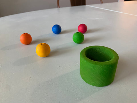 Green cup and rainbow beads