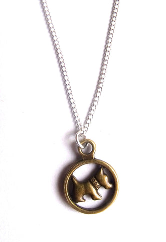 This Material Culture | Puppy pendant