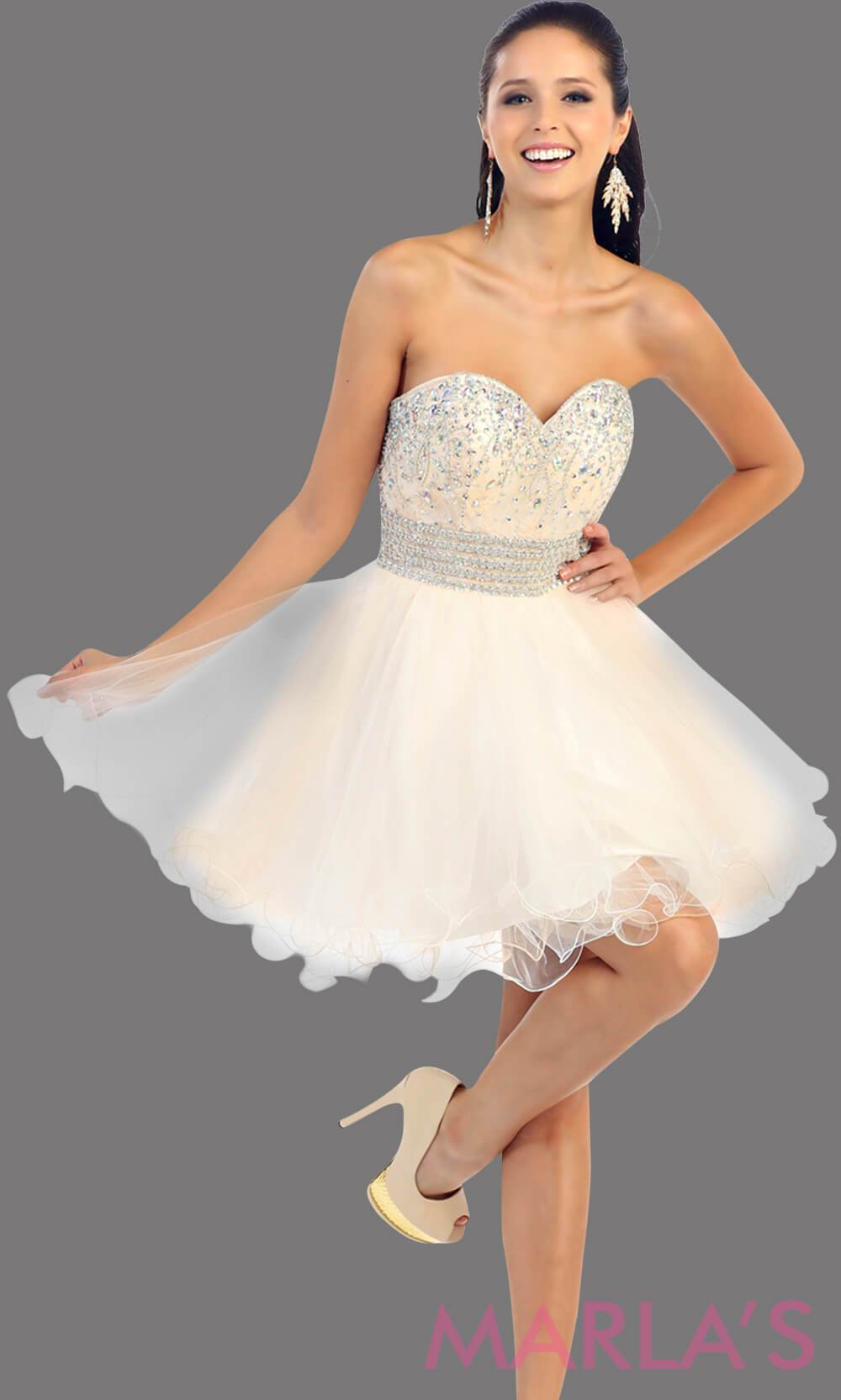 Short puffy champagne dress with a beaded bodice feature a sweetheart neckline and empire waist that flows into layers of tulle. This dress has a corset back and avail in plus size. Perfect for grade 8 graduation