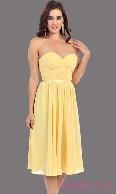 Mid length strapless flowy yellow dress. This dress features a corset back, full a line skirt, and built in cups. Perfect for a grade 8 graduation dress, or bridesmaid dress for destination wedding. Avail in plus size
