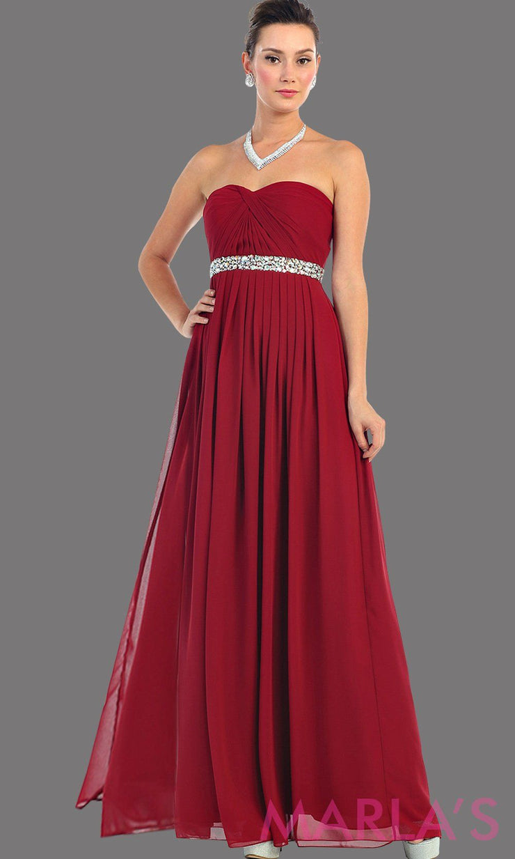 Long burgundy flowy dress with corset back. It has a multicolor rhinestone belt under the bust. Perfect for bridesmaid dresses, simple prom dress, and wedding guest dress. This is available in plus sizes