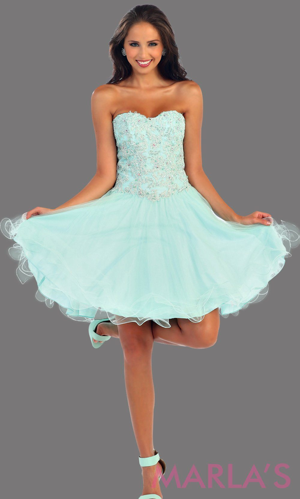 Short strapless aqua sweetheart dress with a puffy skirt. The beaded sequin bodice has a corset back. This blue dress is perfect for grade 8 graduation, damas, homecoming or birthday party. Available in plus sizes.