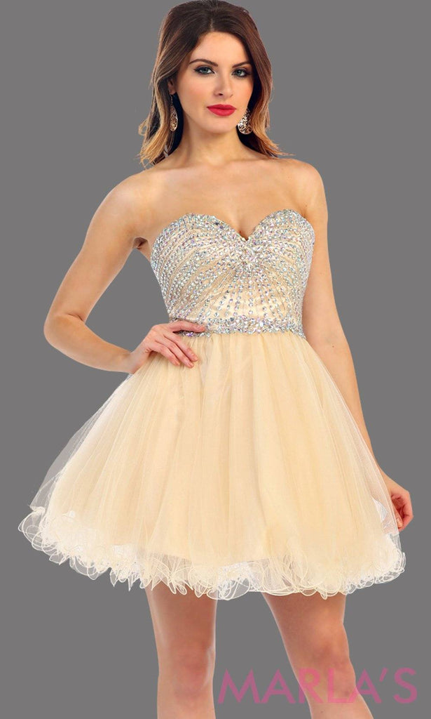 Short puffy champagne strapless dress with a beaded bodice. It has a corset bodice with tone on tone beading. This is perfect for grade 8 graduation, homecoming, gold damas. Available in plus sizes