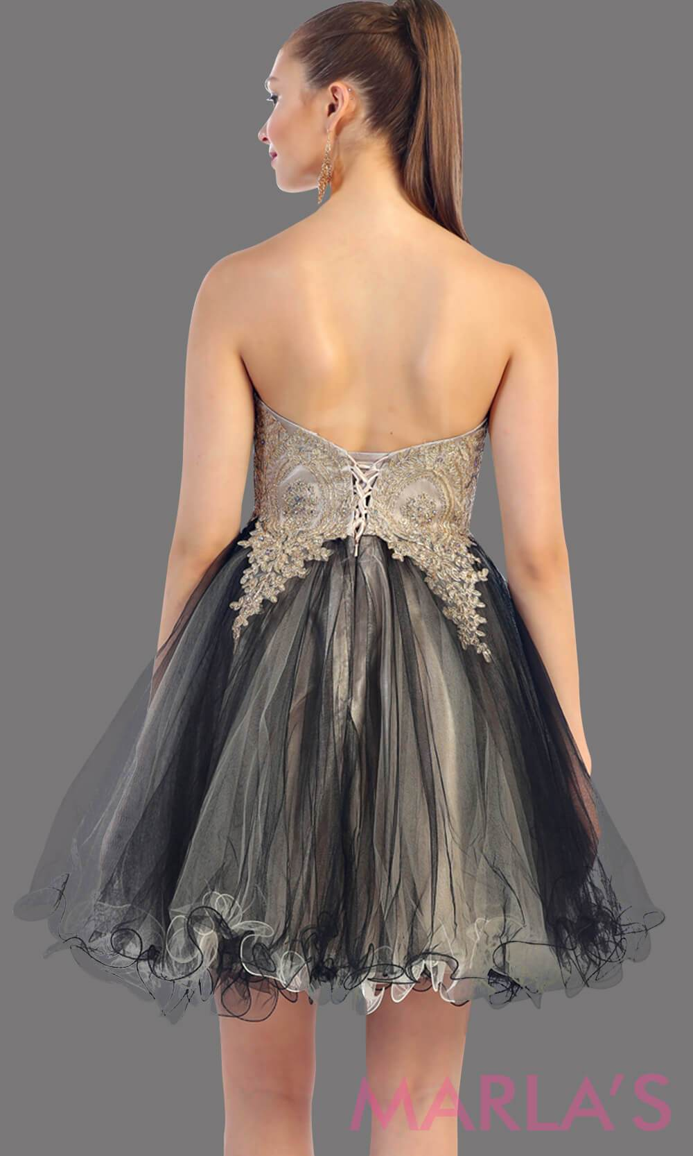 Back of short two tone strapless puffy black dress with a corset back. This is a perfect grade 8 grad dress, black graduation dress, homecoming, semi formal, bridal shower. Available in plus sizes