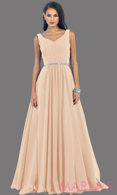 This beautiful gown has wide straps with a rhinestone belt. It flows into a full a-line chiffon skirt.