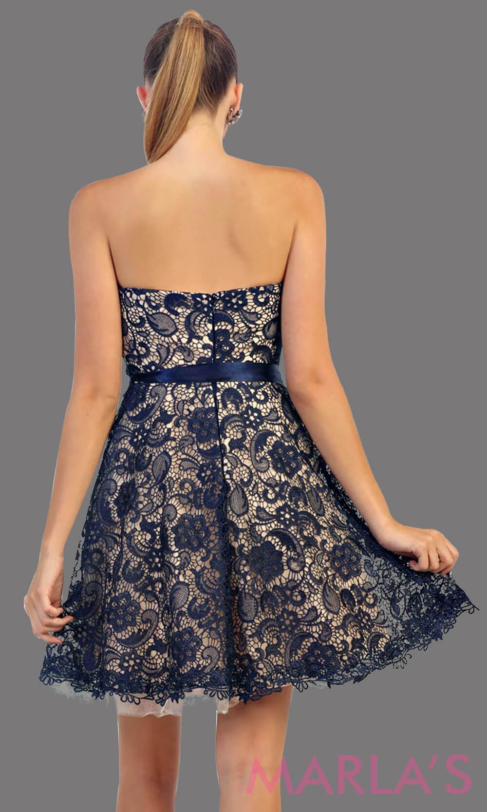Back of short strapless navy lace dress with satin ribbon. This dark blue dress is perfect for grade 8 graduation, party dress, semi formal or even homecoming. It is available in plus sizes