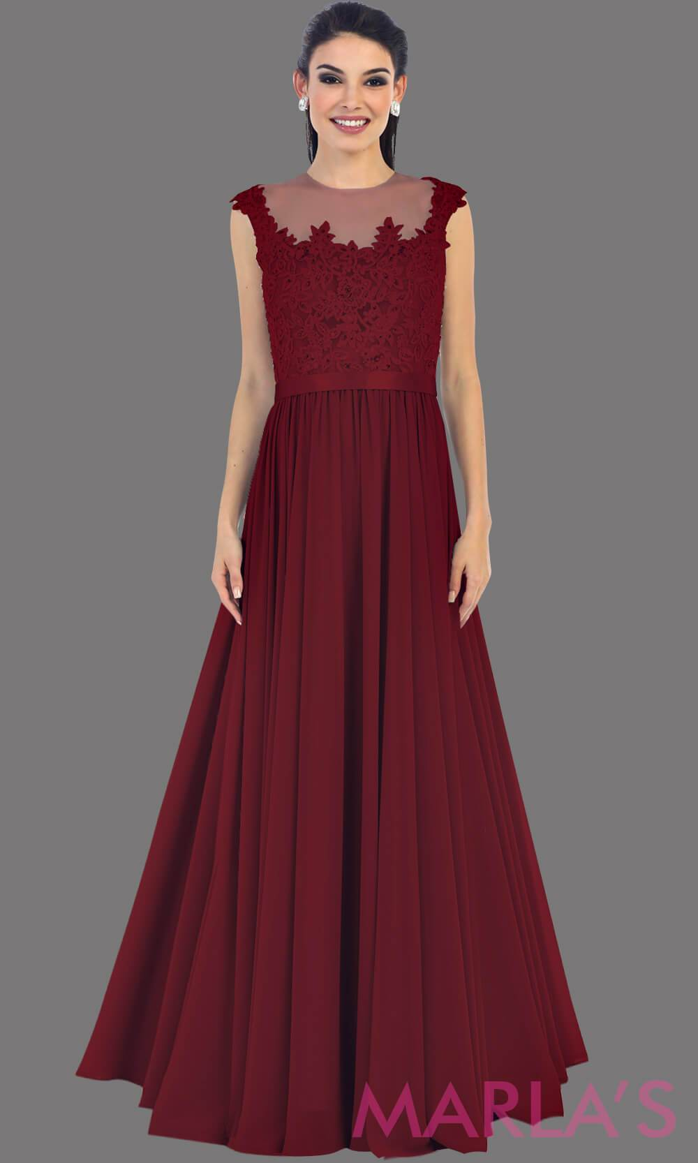 Long burgandy flowy dress with sheer lace bodice. It has a high neck and high back with an illusion neckline. The dark red is a perfect wedding guest dress for a simple party or modest prom dress.