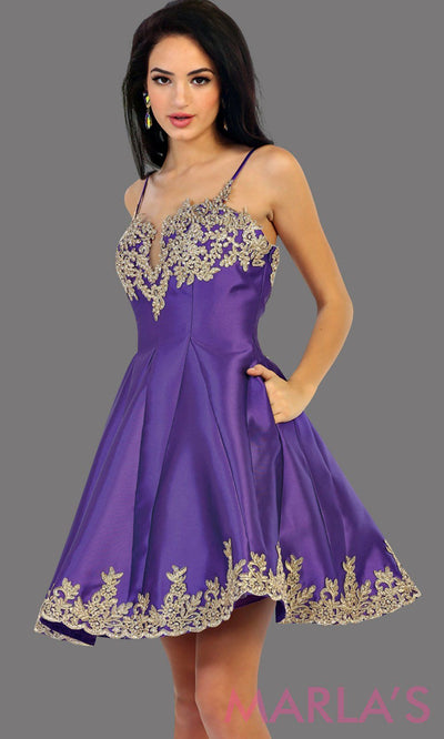 1445-Short satin purple grade 8 graduation dress with gold lace detail and straps. This dress features pockets. Perfect purple short prom dress, confirmation dress, damas, and wedding guest dress. Available in plus sizes.