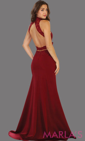 Back of Long burgundy open back fitted dress. Low back dark red gown is perfect for prom, formal gala, formal wedding, reception, engagement dress. Features high neck with illusion waist, neckline, low back.