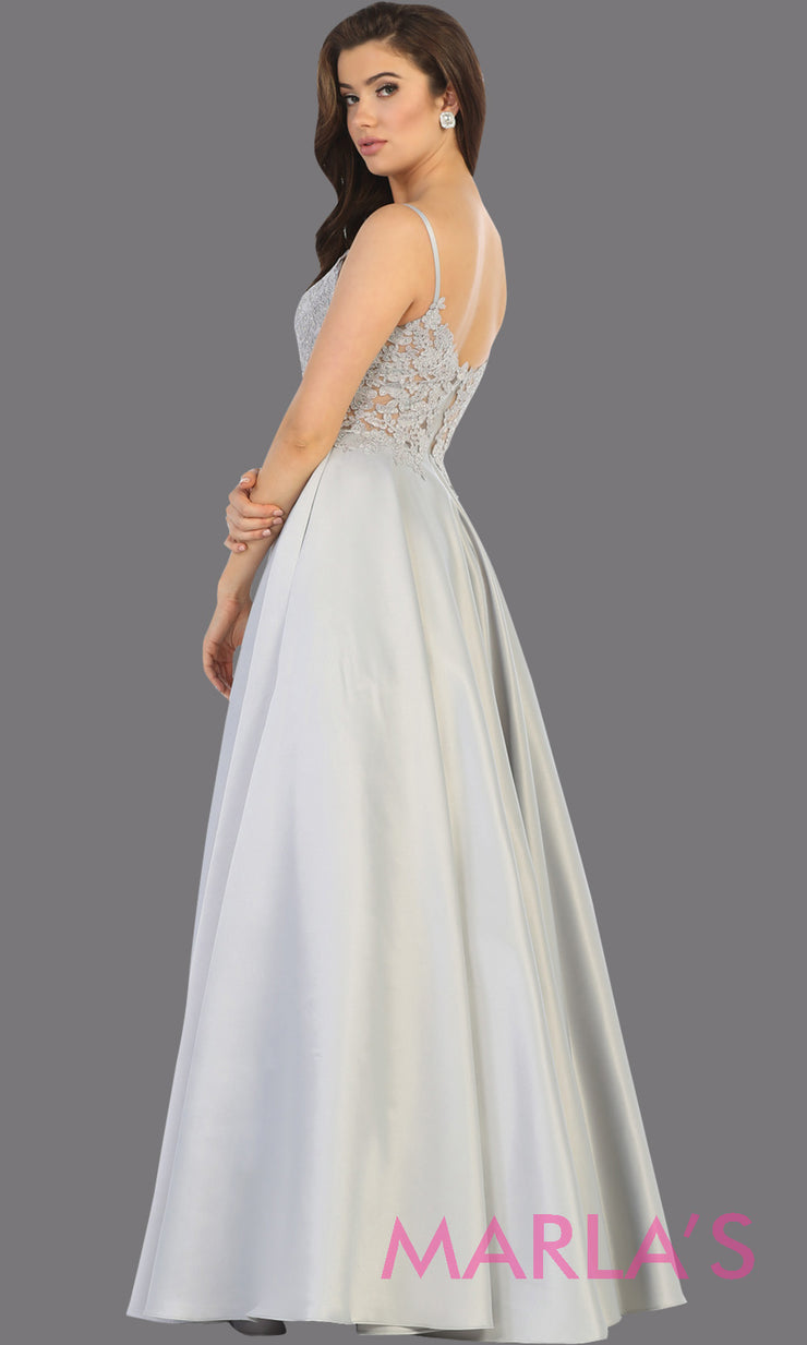 Back of Long simple v neck silver semi ballgown with pockets.This light grey flowy gown from mayqueen is perfect for prom, black tie event, engagement dress, formal party dress, plus size wedding guest dresses, bridesmaid, indowestern party dress