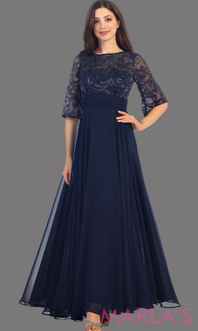 Long flowy navy dress with sequin top and bell sleeve. The bodice has tone on tone beading with empire waist. Perfect for a modest dark blue prom dress, long party dress and mother of the bride. Available in plus size.
