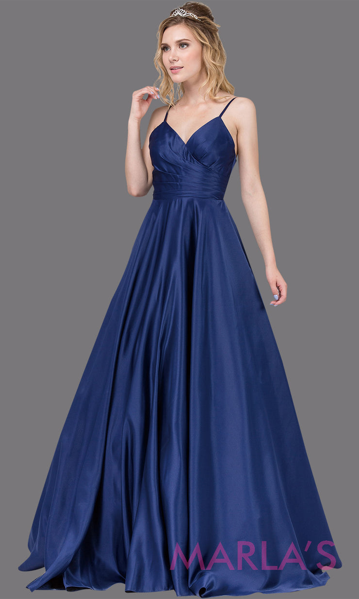 Long simple navy blue semi ball gown in a satin taffeta. Comes with straps, V Neck & skirt has pockets.This dark blue floor length gown is perfect as a navy prom ballgown, wedding reception dress, engagement dress, formal wedding.Plus sizes avail.