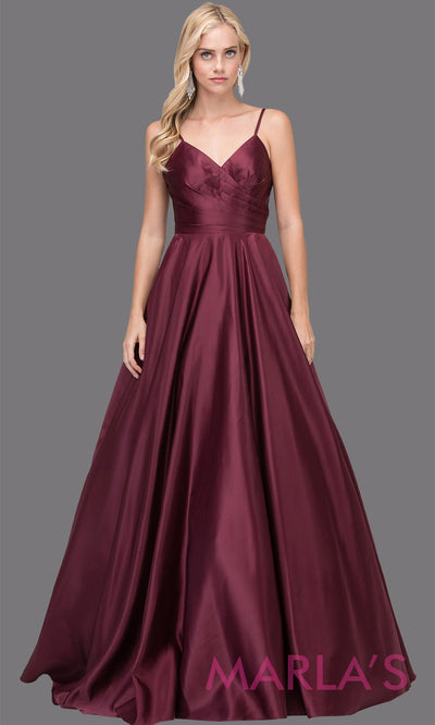 Long simple wine semi ball gown in a satin taffeta. Comes with straps, V Neck & skirt has pockets.This dark red floor length gown is perfect as a maroon prom ballgown, wedding reception dress, engagement dress, formal wedding.Plus sizes avail.