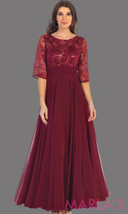 Long flowy burgundy dress with sequin top and bell sleeve. The bodice has tone on tone beading with empire waist. Perfect for a modest dark red prom dress, long party dress and mother of the bride. Available in plus size.