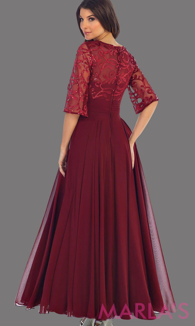 Back of Long flowy burgundy dress with sequin top and bell sleeve. The bodice has tone on tone beading with empire waist. Perfect for a modest dark blue prom dress, long party dress and mother of the bride. Available in plus size.