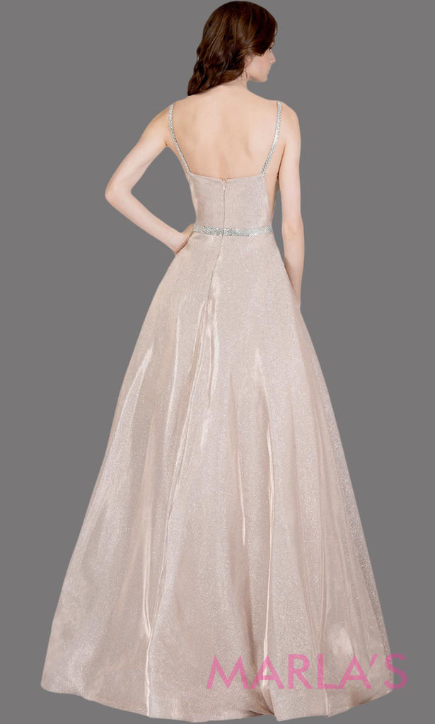 1ec202c96d Long metallic emerald green semi ball gown with low back. This green formal  high neck
