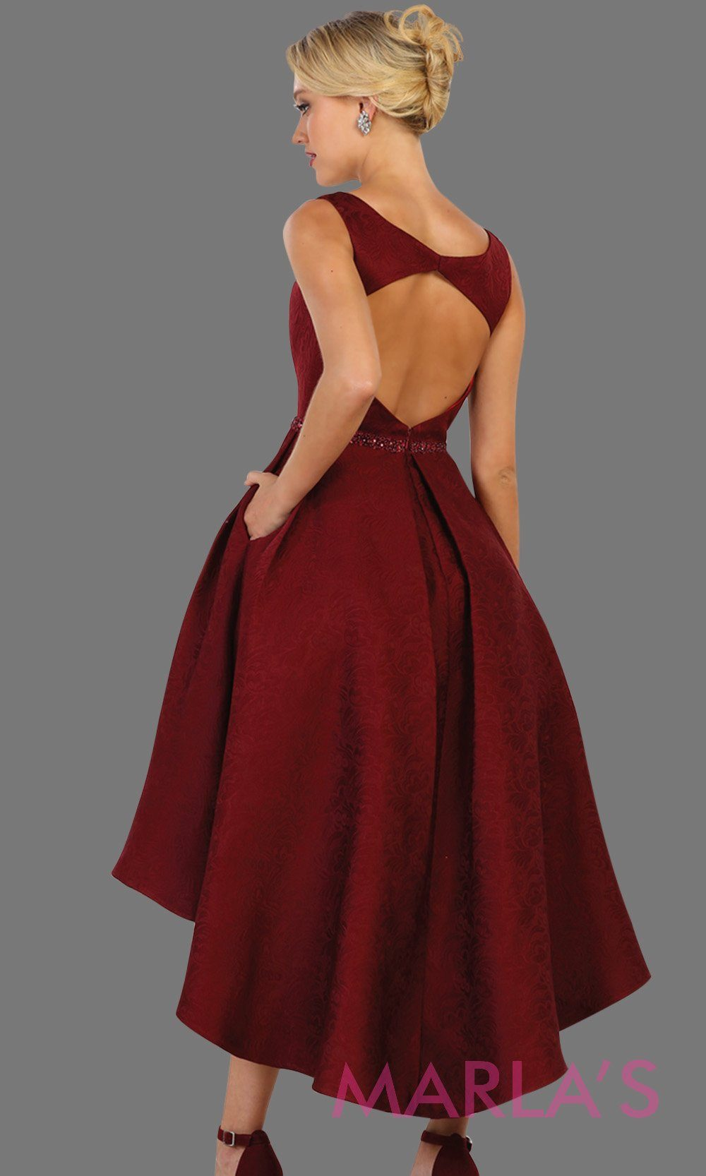 Back of High low burgundy high neck dress with open back. Perfect for graduation, grade 8 grad, red hi lo prom dress, wedding guest dress, formal party gown, gala, semi formal, engagement dress.Available in plus sizes.