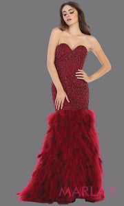 Long strapless burgundy mermaid evening gown with feathers from MayQueen RQ7668. This dark red gown is perfect for prom, wedding reception, engagement dress, e-shoot, prom, formal wedding guest dress, indowestern party dress, plus size