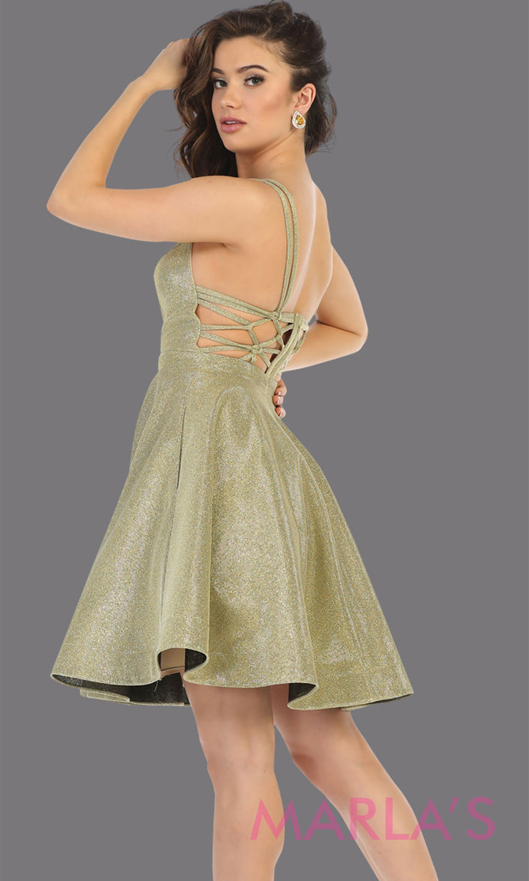 Back of Short gold v neck flowy open back dress from MayQueen RQ7749. This gold metallic gown is perfect for grade 8 grad, graduation, confirmation dress, homecoming, engagement shoot, e shoot, quinceanera damas, plus size formal party semi dress
