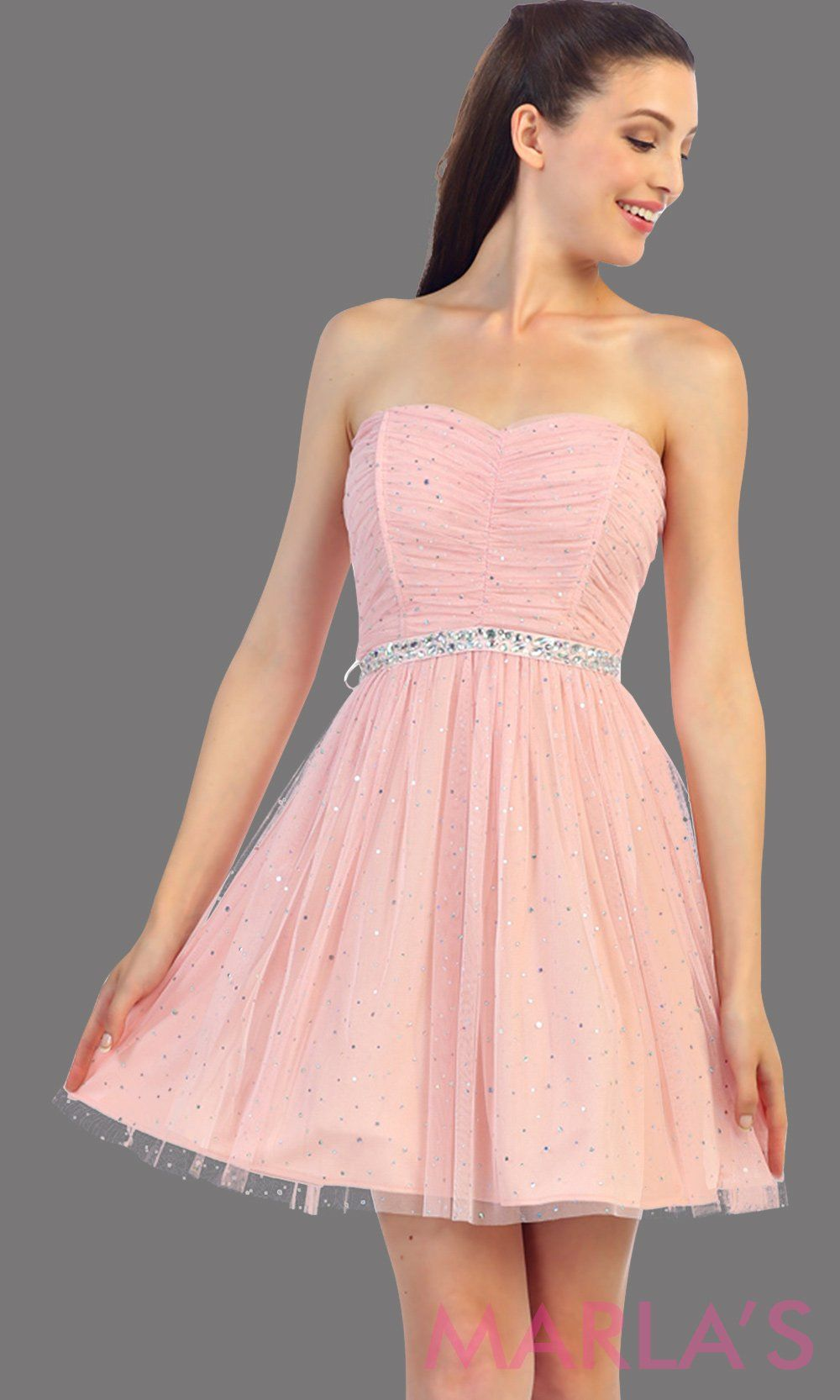 Short strapless pink dress with removable satin belt. The sheer mesh and light fabric has glitter within it. This is the perfect blush grade 8 graduation dress, damas dress, confirmation dress, or even homecoming dress
