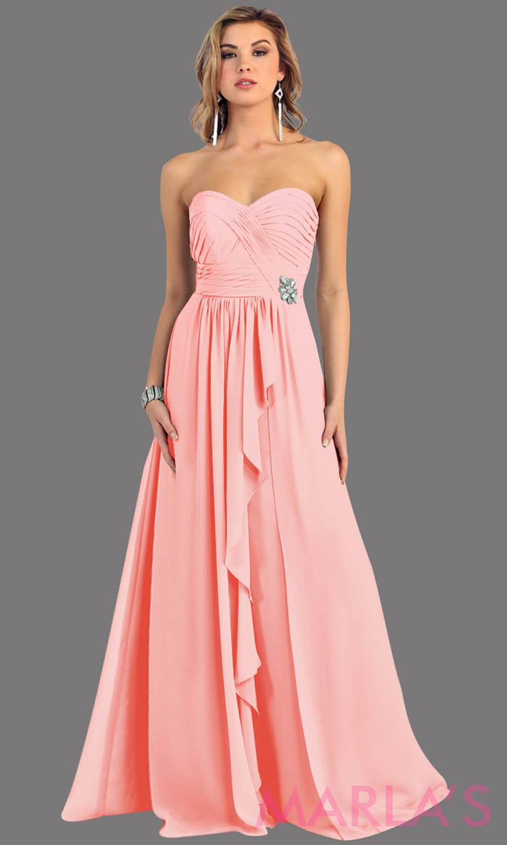 This is a simple, strapless blush dress with a flowy a-line skirt. It has a ruched bodice and is perfect for prom, bridesmaid dresses, or even as a wedding guest. This pink long gown is available in plus sizes