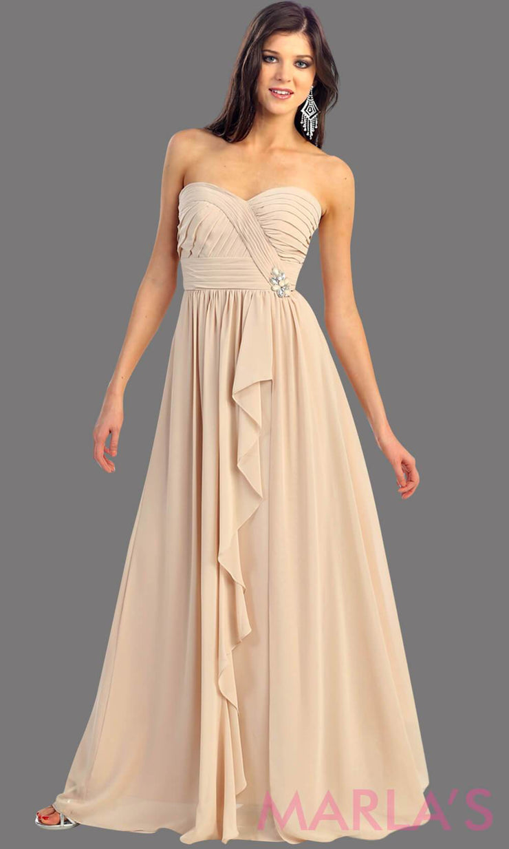 This is a simple, strapless champagne dress with a flowy a-line skirt. It has a ruched bodice and is perfect for prom, bridesmaid dresses, or even as a wedding guest. This long gown is available in plus sizes
