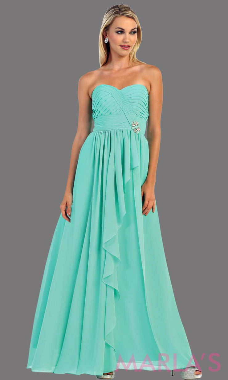 This is a simple, strapless mint dress with a flowy a-line skirt. It has a ruched bodice and is perfect for prom, bridesmaid dresses, or even as a wedding guest. This long gown is available in plus sizes