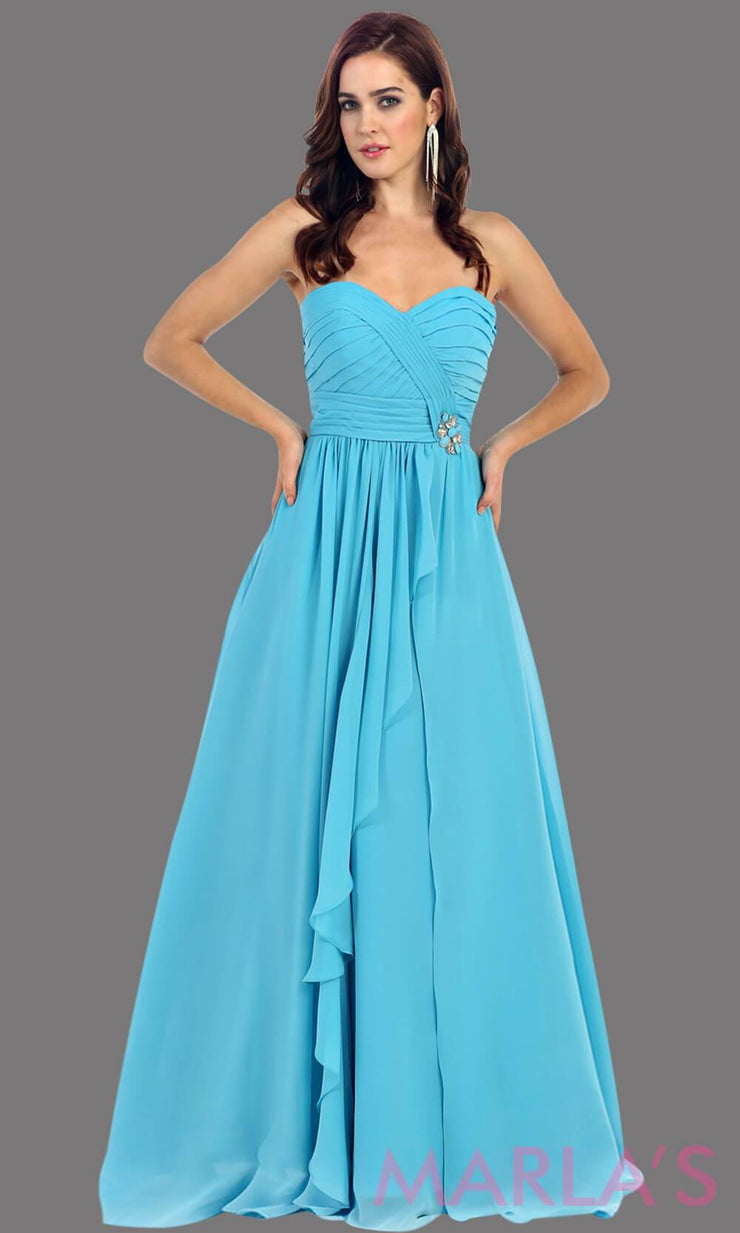 This is a simple, strapless torquoise dress with a flowy a-line skirt. It has a ruched bodice and is perfect for prom, bridesmaid dresses, or even as a wedding guest. This blue long gown is available in plus sizes