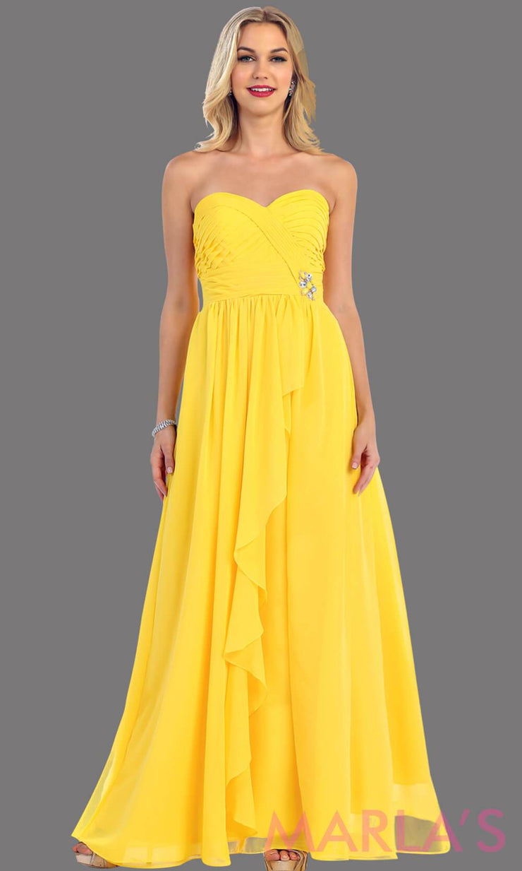 This is a simple, strapless yellow dress with a flowy a-line skirt. It has a ruched bodice and is perfect for prom, bridesmaid dresses, or even as a wedding guest. This yellow long gown is available in plus sizes