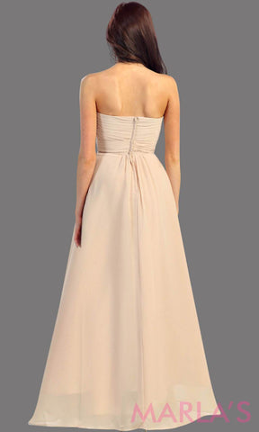 This is the back of a simple, strapless champagne dress with a flowy a-line skirt. It has a ruched bodice and is perfect for prom, bridesmaid dresses, or even as a wedding guest. This long gown is available in plus sizes