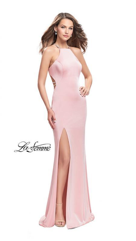 La Femme 25459 blush prom dress. This is a beautiful pink open back prom dress. It features a high neck with a high slit. Sleek and sexy prom dress