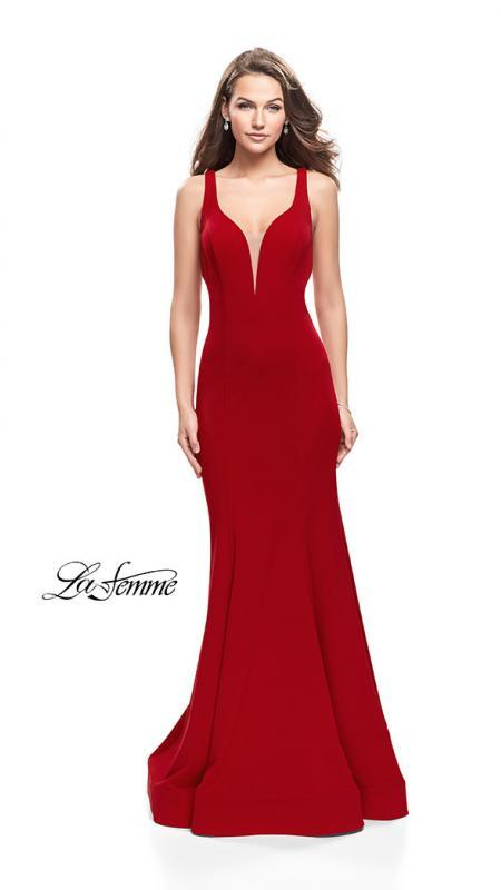 La Femme 25594 red prom dress. This is a beautiful red open back prom dress. It features a v neck with a fitted skirt. Sleek and sexy prom dress