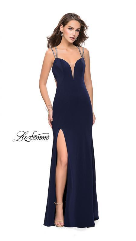 La Femme 25660 navy prom dress. This is a beautiful dark blue open back prom dress. It features a v neck with a high slit. Sleek and sexy prom dress