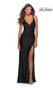 La Femme LF28289 long black prom tight fitted sexy prom dress with open back & high slit. This black sleek and sexy, low back formal full length evening gown with leg slit is perfect for 2020 prom dresses